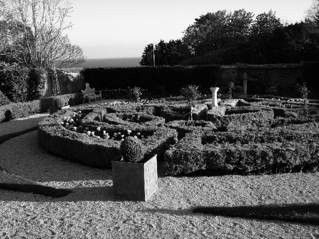 Rosteague's formal box parterres are protected from the sea winds by a wall of cob