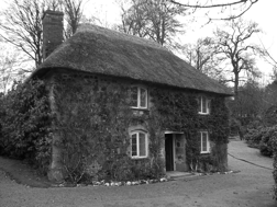The cottage in the Higher Garden, retained as a picturesque 'incident' in the early 19th-century Flower Garden.