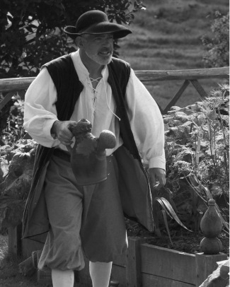 Mark Harrandon as 'William Woad', the Tudor gardener at Trerice, holding one of the replica clay Tudor watering cans that are in use at the Elizabethan garden