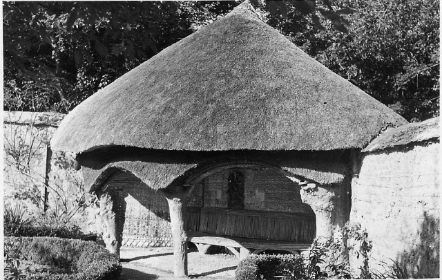 A postcard of the thatched summer-house in the French Garden, c.1912