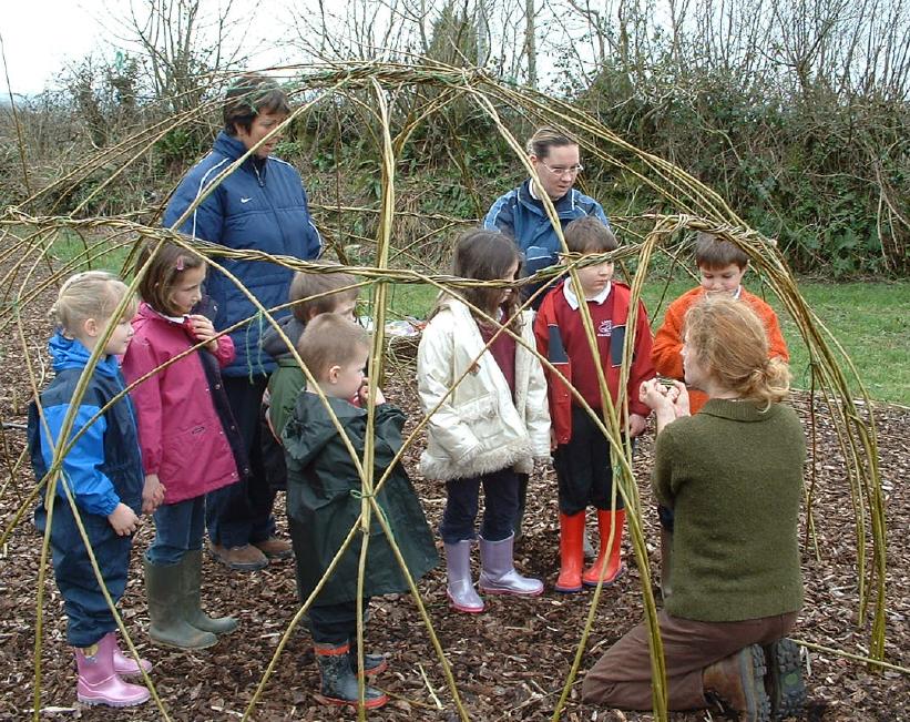 Ele (kneeling) with children of Lanreath School